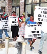 Protesters demonstrating against gentrification.