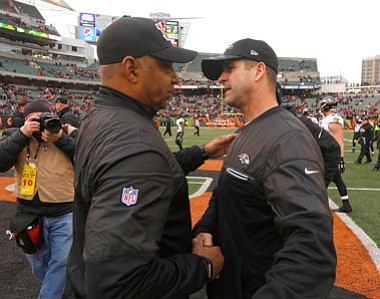 Baltimore Ravens head coach John Harbaugh shakes hands with Bengals head coach Marvin Lewis after the final game of the 2016 season. The Ravens and the Bengals kick off the 2017 NFL season on Sunday, September 10 in Cincinnati.
