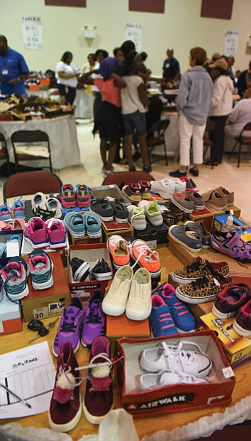 Volunteers also were on hand Monday to help youngsters make shoe selections at the program's second location at New Deliverance Evangelistic Church Annex on Turner Road.