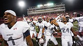 Howard University players celebrate their surprise 43-40 victory last Saturday over University of Nevada-Las Vegas at Sam Boyd Stadium in Las Vegas.