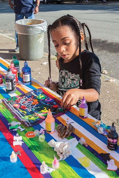 Jaliah Jackson, 4, designs her own binder pouch, at the Back-to-School Block Party held Sunday at the Richmond Association of Masonic Lodges on North 25th Street in preparation for the first day of school.