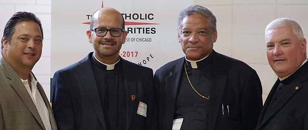 From left to right: State Rep. Bob Rita, Rev. Diego Cadavid of St. Donatus Parish in Blue Island, Bishop Joseph Perry and Monsignor Michael Boland of Catholic Charities.