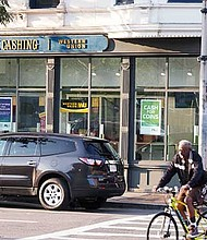 PLS Check Cashing replaced A Nubian Notion at a prominent corner storefront in Dudley Square.