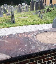 The crypt in which eight members of the Dudley family's remains are entombed in the Eliot Burying Ground. Legend has it that the pewter memorial that once graced the top was melted down to make bullets during the Revolutionary War.