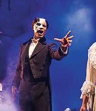 """Derrick Davis, as The Phantom, and Eva Tavares, as Christine Daaé, in """"Phantom of the Opera."""""""
