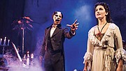 "Derrick Davis, as The Phantom, and Eva Tavares, as Christine Daaé, in ""Phantom of the Opera."""