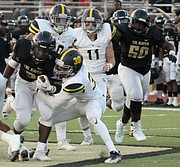 Chris Witherspoon gets some critical yards for Whitehaven. (Photo: Terry Davis)