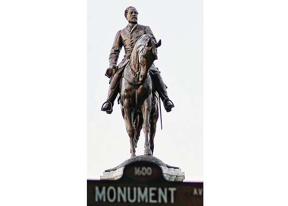 In defiance of Gov. Terry McAuliffe's ban on demonstrations at the Robert E. Lee statue on Monument Avenue, a little ...