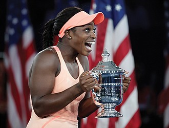 Sloan Stephens jubilantly holds her trophy last Saturday after beating Madison Keys to win the singles title at the U.S. Open tennis tournament in New York.