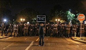"""Protesters holds """"Black Lives Matter"""" sign during protests in St. Louis after ex-officer Jason Stockley was found not guilty."""
