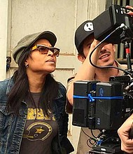 Jade Jenise Dixon on set with cinematographer.