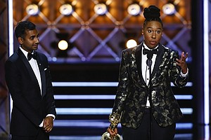 Lena Waithe accepts the Emmy Award for Outstanding Writing for a Comedy Series at the 69th Primetime Emmy Awards, Sunday, September 17, 2017. She is the first African American woman to win an Emmy for comedy writing.