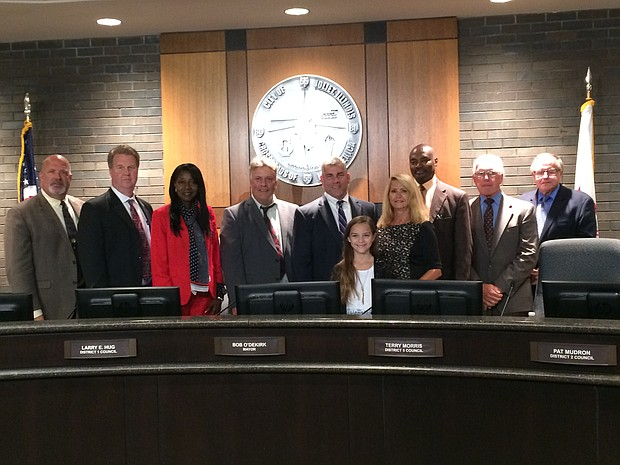 Danica Ward, center, was recognized by the Joliet City Council for her efforts to collect supplies following Hurricane Harvey.