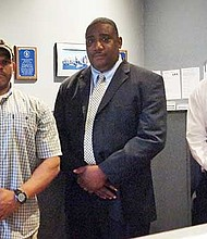 Matt Breveleri (left), operations manager; Larry Celester (center), co-founder and operations director; and Jordan Wimberly (right), who will take over temporarily from Breveleri when he is deployed by the military in November. The three met with the Banner at 1st Amor's headquarters, near Fields Corner.