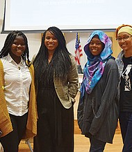 City Councilor Ayanna Pressley enjoys a moment with students during a focus group she convened for the national Black Women's Justice Institute.