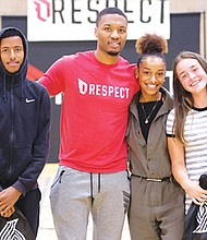 Roosevelt High School students Lammi Kalil (from left), Justice English and Isobel Boyd join Portland Trail Blazers point guard Damian Lillard (center) at a school assembly Thursday to kick off  a motivational 'RESPECT' program that focuses on encouraging students to adopt core values through respectful behavior.