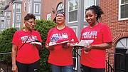Walsh campaign volunteers Gail Forbes-Harris, Cherose Singleton and Tymecha Furrow door knock on Circuit Street in Roxbury.