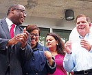 District 7 City Councilor Tito Jackson and Mayor Martin Walsh prepare to cut the ribbon on the newly-renovated Freedom Housebuilding in Grove Hall. Behind are state Rep. Chynah Tyler, at-large Councilor Anissa Essaibi George and state Sen. Sonia Chang-Diaz.