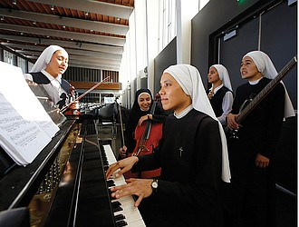Members of Siervas, a Peruvian-based rock 'n' roll band composed entirely of Catholic nuns, rehearse on Sept. 7, a day ahead of their performance at the Christ Cathedral campus in Garden Grove, Calif. The sisters insist they aren't rock stars though they're being considered for a nomination for a Latin Grammy and their concerts draw thousands.
