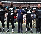 Players from the Jacksonville Jaguars and team owner Shahid Kahn stand united during the National Anthem