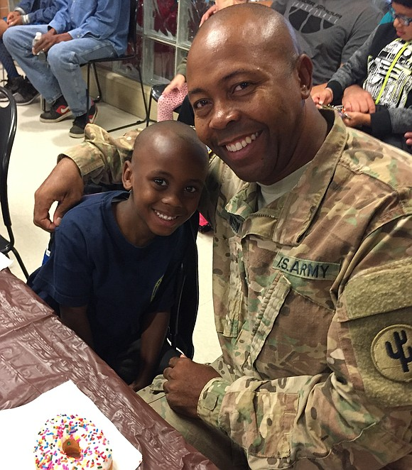"Troy Hofer Elementary School kindergartner Zyir Johnson called it his ""best day ever,"" when his father surprised him at a ..."