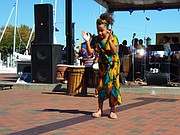 Young dancer from Keur Khaleyi African Dance Company performs