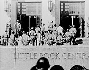 This September 1957 photo shows the nine African-American students being escorted into Little Rock's Central High School by troops from the Army's 101st Airborne Division.