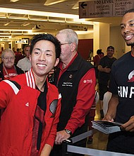 A selfie with Trail Blazers point guard Damian Lillard is a big moment for a young fan at a prior Wells Fargo Fan Fest at the Moda Center.  The 13th annual event returns, Sunday afternoon, Oct. 1. Free digital tickets are available at trailblazers.com/fanfest. (Photo from NBA.com)