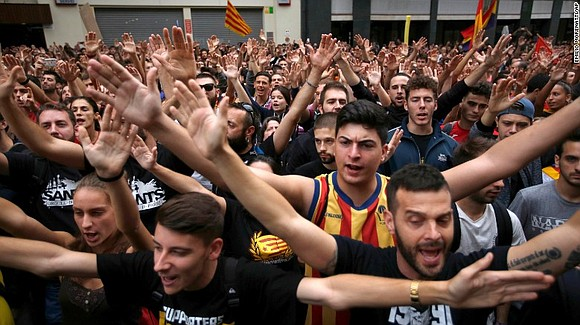 The center of Barcelona was brought to a halt Tuesday as Catalans vented their anger at the violent crackdown by ...