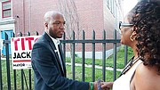 District 7 City Council candidate Rufus Faulk greets voters outside the Lewis
