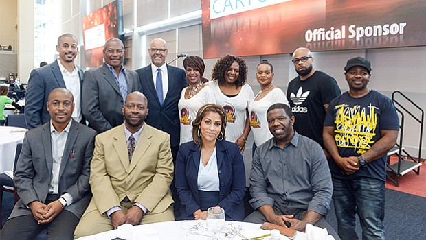 Members of The Bass Radio Station (WZBR, 1410AM) family sponsored the GNEMSDC luncheon. They pose here with Peter Hurst, President & CEO of the GNEMSDC (second row, third from the left).