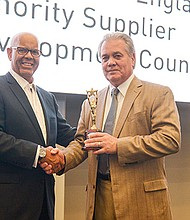 (left) Peter Hurst, President & CEO of the GNEMSDC, presents Richard Witcher, co-owner of Minuteman Trucks, Inc. with the Shining Star Award. Witcher accepted the award on behalf of his brother, William. They are equal owners of the company. Minuteman was recognized for its longstanding support of the GNEMSDC and its initiatives.