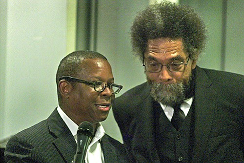 Kevin Peterson (L), founder of the New Democracy Coalition and sponsor of the evening with Dr. Cornel West takes a moment with West to help field audience response