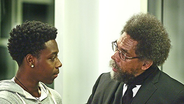 Dr. Cornel West takes a moment with a young audience member, Jeysaun Gant, to answer his question with a thoughtful, direct comment.