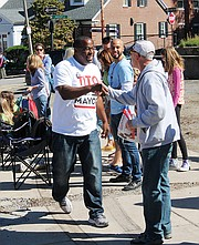 Mayoral candidate Tito Jackson campaigns during the Roslindale Day Parade.
