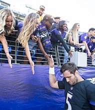 Fans reach out to dejected Ravens quarterback Joe Flacco after the team's 26-9 loss to the Pittsburg Steelers on Sunday, October 1, 2017 at M&T Bank Stadium in Baltimore.