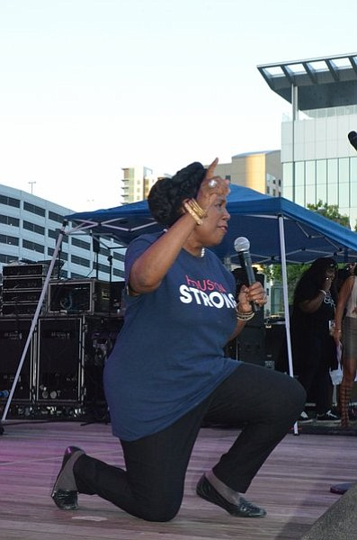 Congresswoman Sheila Jackson Lee taking a knee at the 2017 Houston Black Heritage Fest