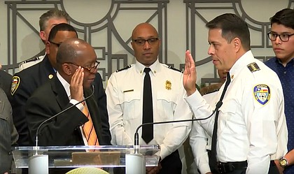 Mayor Sylvester Turner swearing in Samuel Pena as the Houston Fire Department Chief