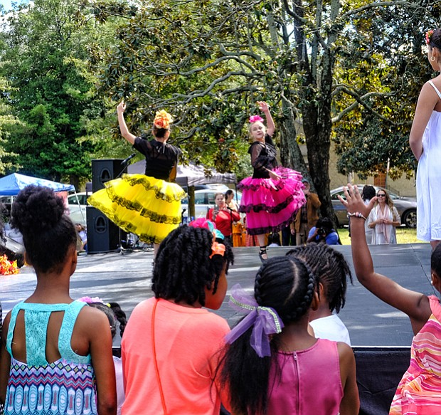 Celebrating peace and diversity // children are enthralled as members of the Latin Ballet of Virginia dance at the 14th Annual Richmond Peace Festival last Saturday at St. Joseph's Villa. A creation of the faith community, the event celebrates peace, diversity and community and includes an interfaith service. The ballet was among an array of entertainers, ranging from rappers to African and Chinese dancers and spoken word artists.