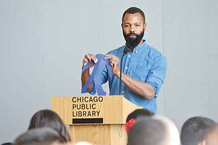 Author and Illustrator Javaka Steptoe conducts a art workshop in front of 300 hundred students at the Harold Washington Library Center. Photo Credit: Christopher Shuttlesworth