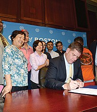 Mayor Martin Walsh signs the Jim Brooks Stabilization Act.