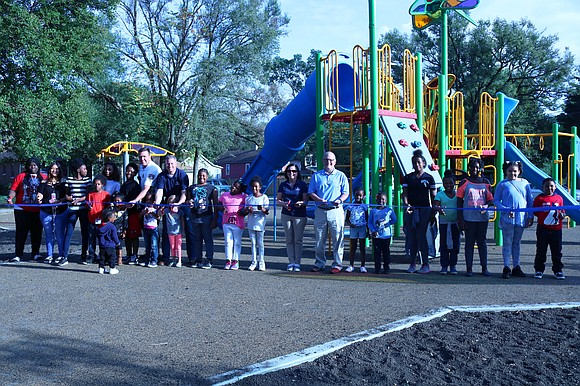 Joliet Park District officials, residents and other community members celebrated the grand opening of Warren-Sharpe Park with a ribbon cutting.