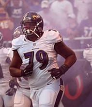 Ravens left tackle Ronnie Stanley runs onto the field before a preseason matchup against the Washington Redskins in August 2017. Stanley who went to high school in Las Vegas donated $1000 for every pass play he didn't give up a sack, pressure or hurry. The total amount of his donation was $26,000.