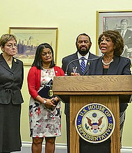 Rep. Maxine Waters (D-Calif.) speaks from the podium about The Megabank Accountability and Consequences Act. Waters is flanked by (from left-right) Reps. Keith Ellison (D-Minn.); Marcy Kaptur (D-Ohio), Pramila Jayapal (D-Wash.); Al Green (D-Texas), and John Sarbanes (D-Md.). - Photo by Freddie Allen/AMG/NNPA