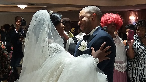The Rev. Al Sharpton's eldest daughter, Dominique, marries Dr. Marcus Alan Bright during a ceremony at Greater Allen AME Cathedral ...