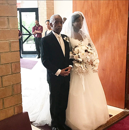 Rev. Al Sharpton walks his daughter Dominique down the aisle.
