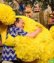 """These big feelings are OK,"" shop owner Alan tells Big Bird in a ""Sesame Street"" video."