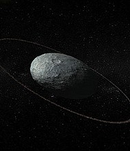 Artist concept of Haumea. The ring is darker than the planet's surface and roughly 2,300 kilometers from its center.