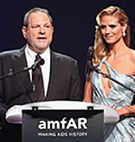 Harvey Weinstein and Heidi Klum speak onstage during amfAR's 21st Cinema Against AIDS Gala on May 22, 2014 in Cap d'Antibes, France.