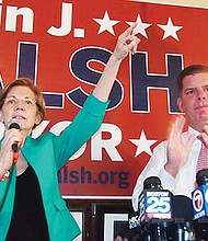 U.S. Sen. Elizabeth Warren endorses Walsh at Doyle's Cafe in Jamaica Plain.